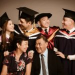 Convocation Photoshoot Package Singapore family candid pictures of 4 university graduates and their grandparents