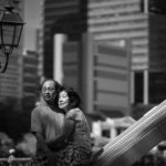 Couple Photography Singapore elderly couple hugging looking at scenery outdoor photoshoot black and white portrait at Singapore River