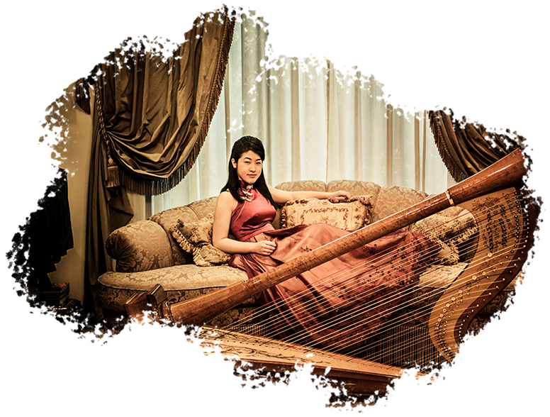 Glamour Photography Singapore woman in modern cheongsam sitting on sofa posing with harp instrument and baroque designed room