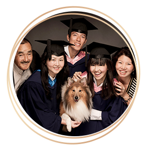 Graduation Photography smiling graduates and family members with pet dog portrait
