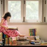 Children Photography Natural lighting large window young girl sitting on and reading books