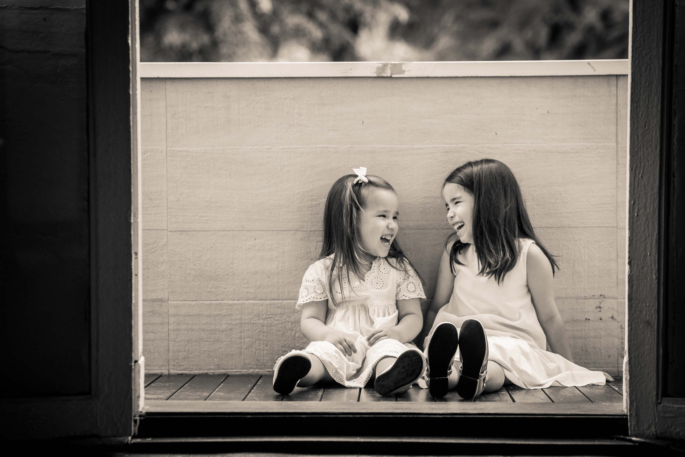 black and white photo of two girls smiling